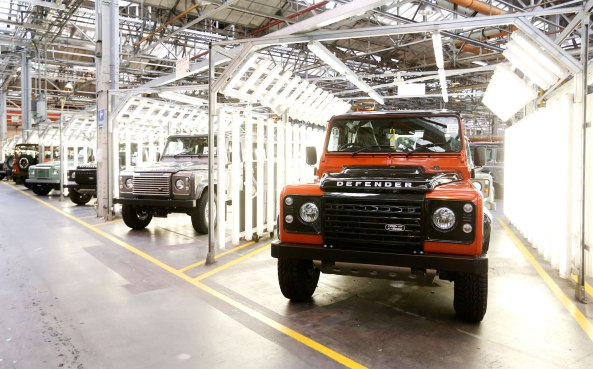 Land Rover Defender automobiles sit in a final inspection area at Tata Motors Ltd.'s Jaguar Land Rover vehicle manufacturing plant in Solihull, U.K., on Wednesday, July, 15, 2015. Jaguar Land Rover, the U.K. luxury-car unit of Tata Motors Ltd., cut its sales targets and prices in China amid slowing demand in the world's largest auto market.  Photographer: Chris Ratcliffe/Bloomberg